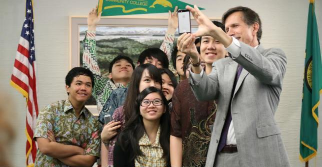 U.S. Ambassador to Indonesia Robert Blake takes a group selfie with Indonesian students at a welcome reception.