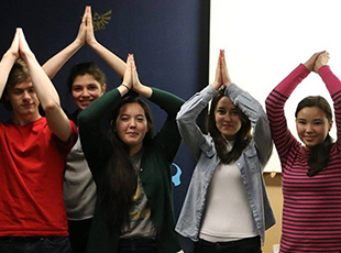 Shoreline Scholars recipients in the fins up gesture