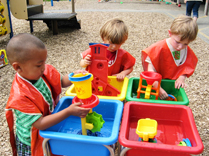 Children playing on playground at childcare center