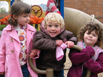Children smiling and playing at childcare center playground